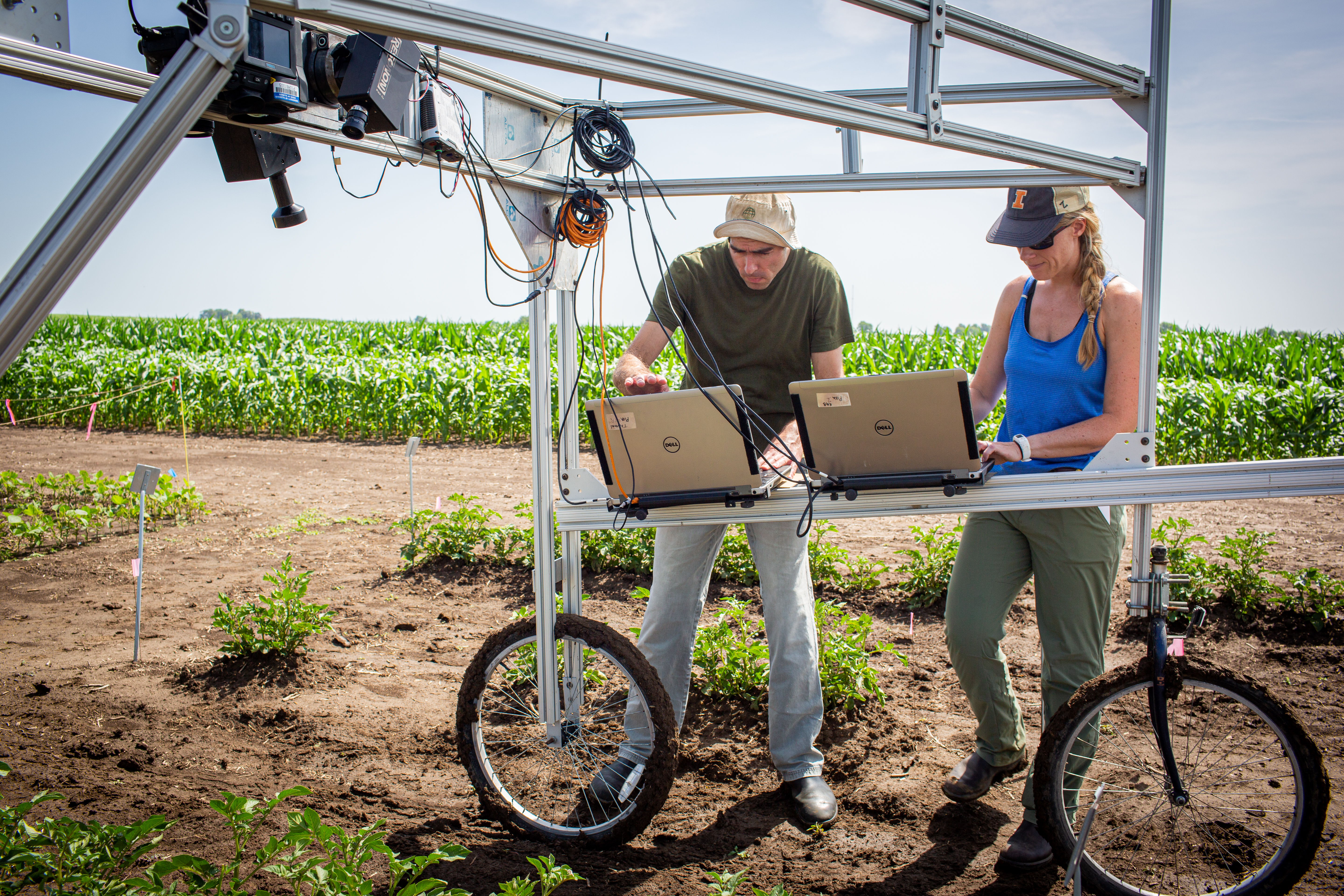 University of Illinois Research Technician Evan Dracup (left) and Postdoctoral Researcher Katherine Meacham-Hensold (right) use hyperspectral cameras to screen entire research plots for high-yielding photosynthesis traits. Two recent publications are making this technology available to more scientists.