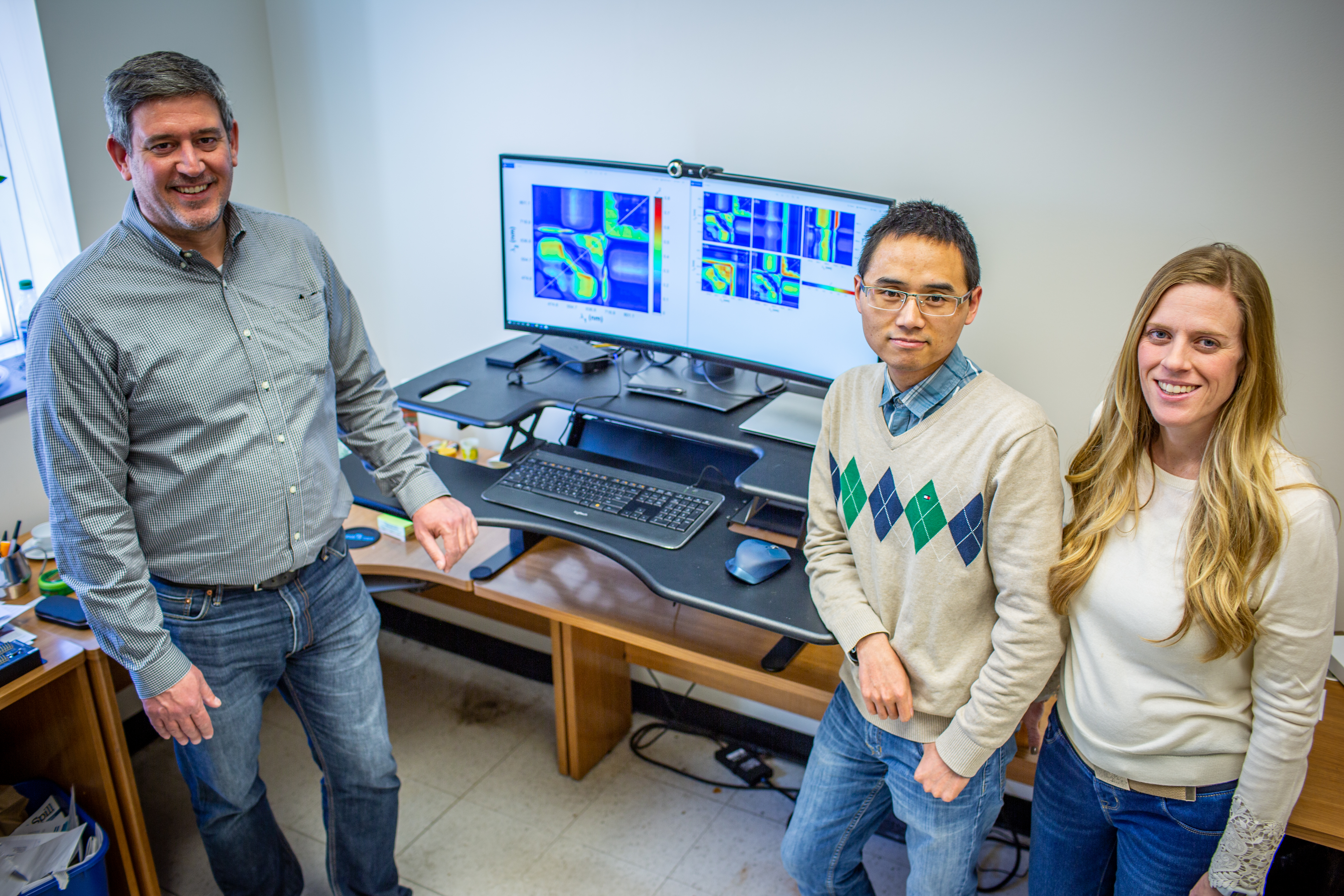 USDA-ARS Research Plant Physiologist Carl Bernacchi (left) with Postdoctoral Researchers Peng Fu (middle) and Katherine Meacham-Hensold (right)
